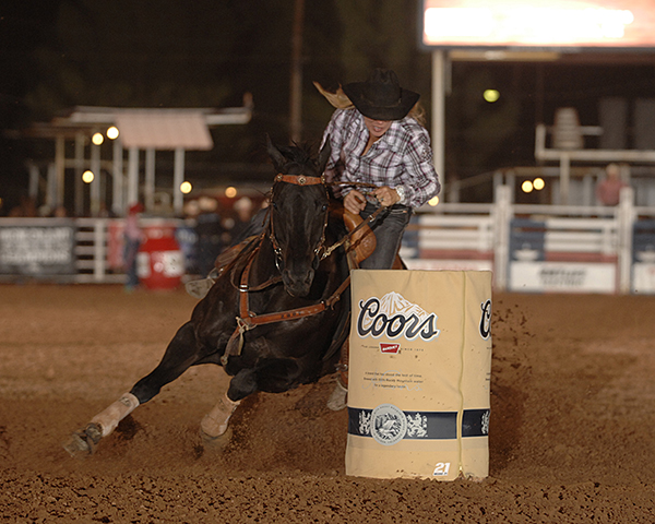 Stacey Grimes of Kerrville, Texas, rounds the second barrel on Saturday night at the West of the Pecos Rodeo. Grimes finished in 17.28 seconds to win the barrel racing championship and the coveted title. (ROBBY FREEMAN PHOTO)