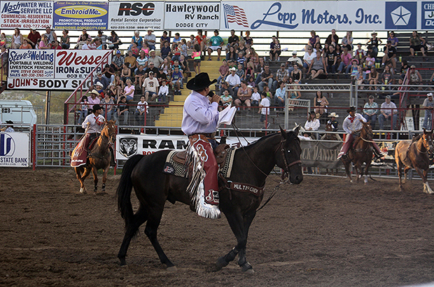 Announcer Boyd Polhamus calls the action via horseback from inside Dodge City Roundup Arena during the 2012 Roundup Rodeo. Polhamus has been a fixture in Dodge City for more than a decade. (TED HARBIN PHOTO)