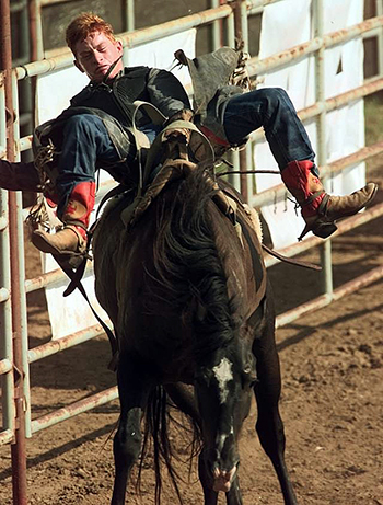 Cord McCoy competes in bareback riding during the International Youth Finals Rodeo about 15 years ago. (OKLAHOMAN PHOTO)