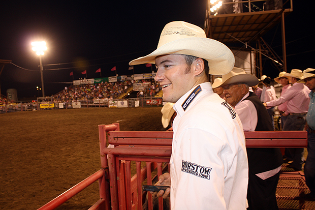 Steven Peebles won the first round of bareback riding at Dodge City Roundup Rodeo and returns to Sunday night's championship round, which is full of Wrangler National Finals Rodeo qualifiers and world champions.