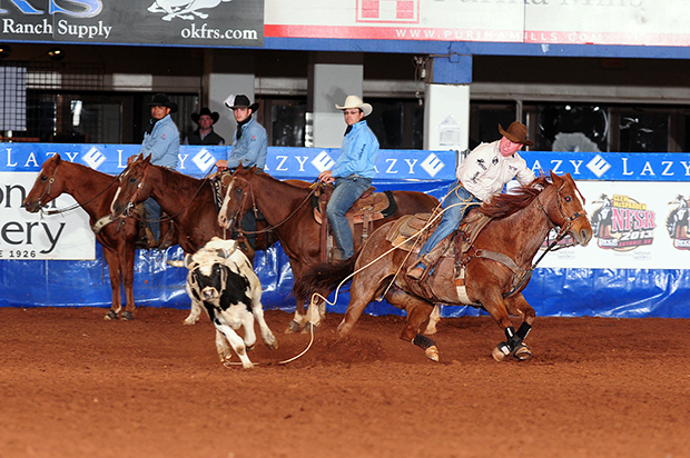 J.P. Wickett won the first and third go-rounds on Friday night to open the two-day Clem McSpadden National Finals Steer Roping, earning $14,231 in the process. He moved from 10th to fifth in the world standings. (JAMES PHIFER PHOTO)