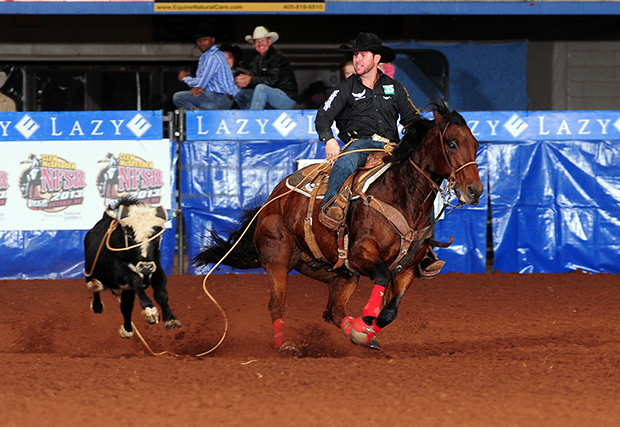 Trevor Brazile clinched his fourth steer roping world title and record-tying 18th overall on Saturday night during the Clem McSpadden National Finals Steer Roping at the Lazy E Arena. (JAMES PHIFER PHOTO)