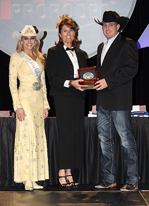Rob Matthews, right, receives the Professional Rodeo Cowboys Association's Media Award for Excellence in Broadcast Journalism on Wednesday night in Las Vegas. Here Matthews poses with Miss Rodeo America Chenae Shiner, left, and Kendra Santos, the PRCA's director of communications.