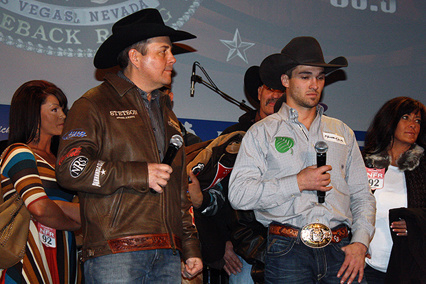 Pete Carr, left, and Caleb Bennett talk about Bennett's ride during the Montana Silversmiths Go-Round Buckle Presentation at the South Point on Thursday night.