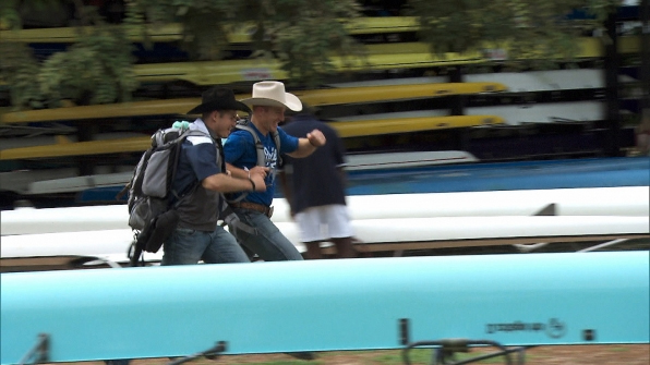 "Cowboy brothers Jet, left, and Cord McCoy make their way to the Pit Stop at the Colombo Rowing Club during the Sunday, March 23, episode of ""The Amazing Race."" The Cowboys finished third in the fifth leg of the race around the world for $1 million. (CBS PHOTO)"