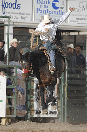 Heith DeMoss rides Pete Carr's Classic Pro Rodeo's Spur Strap for 87 points to win the 2013 Guymon Pioneer Days Rodeo. He's one of nine champions who will defend their titles at this year's event, set for Friday, May 2-Sunday, May 3, in Guymon, Okla. (ROBBY FREEMAN PHOTO)