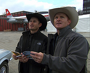 "Cowboy brothers Jet, left, and Cord McCoy must calculate the model year of a Ford Mustang using the corresponding kilometers of two different Swiss cities in order to receive the next clue during the ninth leg of the All-Star Edition of ""The Amazing Race."" (CBS PHOTO)"