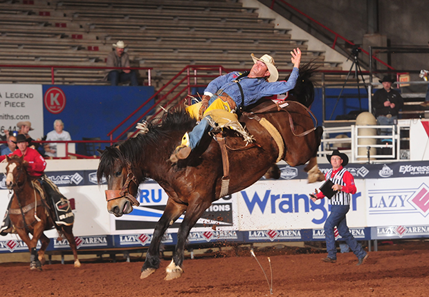 Four-time world champion bareback rider Bobby Mote rides Pickett ProRodeo's Scarlett Fever for 86 points Saturday afternoon to win the second go-round and the average at the Ram National Circuit Finals Rodeo. He advances to Saturday night's semifinals. (PRCA PRORODEO PHOTO BY JAMES PHIFER)