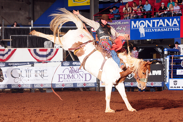 Cody Wright rides Korkow Rodeo's Painted Chip for 83 points to lead the second round at the Ram National Circuit Finals Rodeo. His two-ride cumulative score of 166 points leads the average race heading into the final day. (PRCA PHOTO BY JAMES PHIFER)