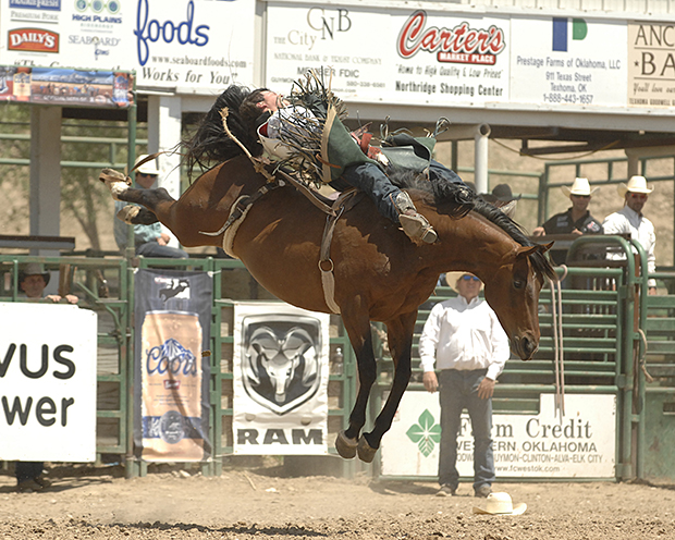 Richie Champion rides Pete Carr's Classic Pro Rodeo's Fancy Free for 86 points on Sunday afternoon to share the bareback riding title (with Tim O'Connell) at the Guymon Pioneer Days Rodeo. (ROBBY FREEMAN PHOTO)