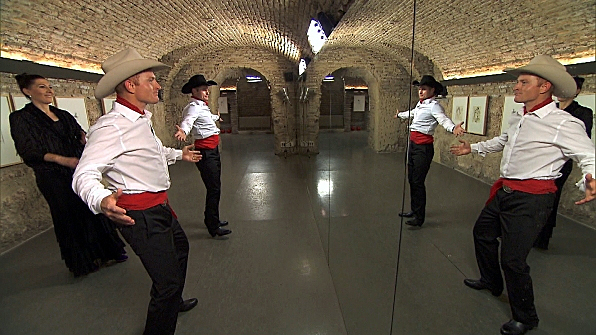 "On a Detour during Sunday's upcoming 10th episode of ""The Amazing Race,"" cowboy brothers Cord, center, and Jet McCoy must learn and perform a Flamenco dance routine in order to receive the next clue. The show will air at 7 p.m. Central on CBS-TV. (CBS PHOTO)"
