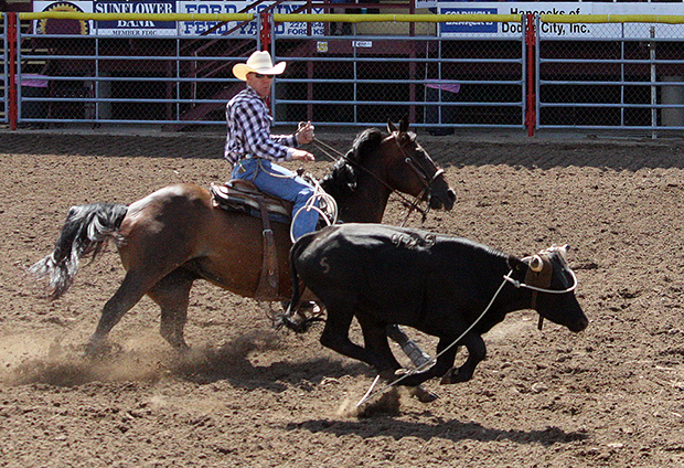 Brodie Poppino of Big Cabin, Okla., the reigning PRCA Steer Roping Rookie of the Year, makes a solid run during the third round of the Dodge City Roundup Rodeo steer roping competition Tuesday afternoon. Poppino finished second in the average.