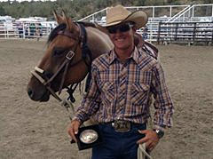 Victor Sundquist shows off his trophy buckle for winning the Colt Starting Challenge USA event in Cortez, Colo., last month.