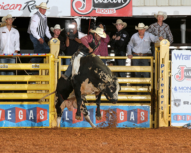 Tim Bingham rides Pete Carr Pro Rodeo's Lineman for 91 points to win the short go-round at the Lea County Xtreme Bulls on Tuesday Night. (PHOTO BY COWBOY IMAGES)