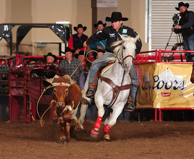 Trevor Brazile ropes on the final night of the Clem McSpadden National Finals Steer Roping. He won the average and the world standings, pocketing $43,858 in NFSR money to finish the season with $112,692. That is a PRCA record for single year earnings in steer roping. His 114.1-second cumulative time on 10 runs also set a record, bettering the mark set by Rocky Patterson in 2001. (JAMES PHIFER PHOTO)