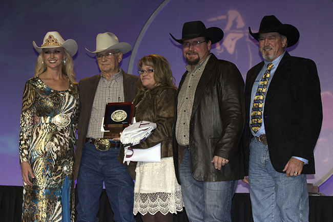 Members of the Will Rogers Stampede Rodeo committee pose with dignitaries during an awards ceremony on Dec. 3 in Las Vegas, where the committee was recognized as the Professional Rodeo Cowboys Association small rodeo of the year. Pictured are, from left, Miss Rodeo America Paige Nicholson, Bob Morton, Dawn Petty, David Petty and Steve Miller with Montana Silversmiths.