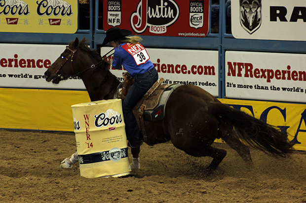 Carlee Pierce and Lolo tip the second barrel on their run during Sunday's fourth round of the Wrangler National Finals Rodeo (LYNETTE HARBIN PHOTO)