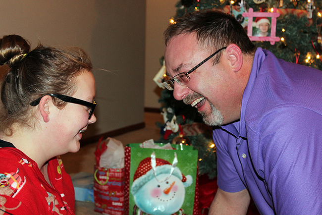 Laney and Ted laugh at his reaction to the beautiful words she wrote to him this Christmas. It wasn't just Ted; Laney did that with all her thoughtful presents. Her insights are meaningful to all those who have received her thoughts. (LYNETTE HARBIN PHOTO)