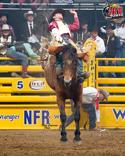 Casey Colletti rides Pete Carr's Classic Pro Rodeo's Scarlet's Web for the 10th-round victory at the 2013 Wrangler National Finals Rodeo. Scarlet's Web is one of five horses sired by the famed Night Jacket that will buck in the 10th round, reserved for the top bucking animals from the season. (MIKE COPEMAN PHOTO)