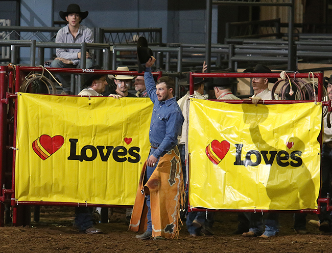 Saddle bronc rider Sean Prater of Muskogee, Okla., acknowledges the crowd after winning his third world championship during IFR 45. (PHOTO BY AMANDA RUTHERFORD, WAY OUT WEST PHOTOGRAPHY)