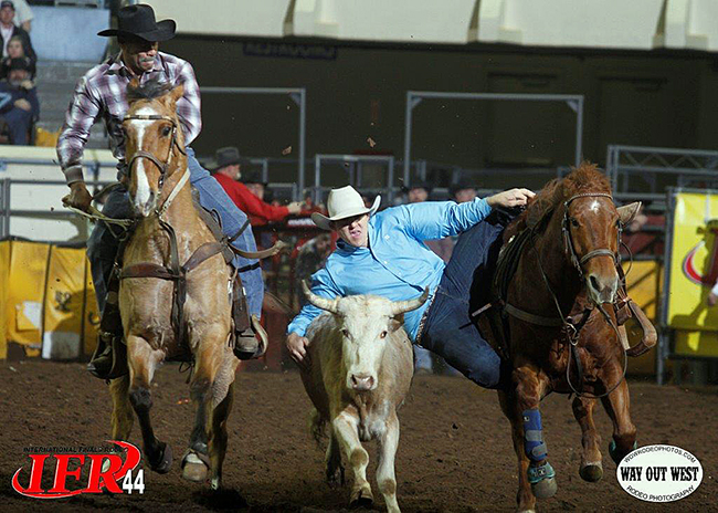 Justin Thigpen competes during IFR 44. Thigpen is the reigning two-time steer wrestling and four-time tie-down roping IPRA world champion. He will be in a battle to win the 2014 title at IFR 45 next week. (AMANDA RUTHERFORD PHOTO)