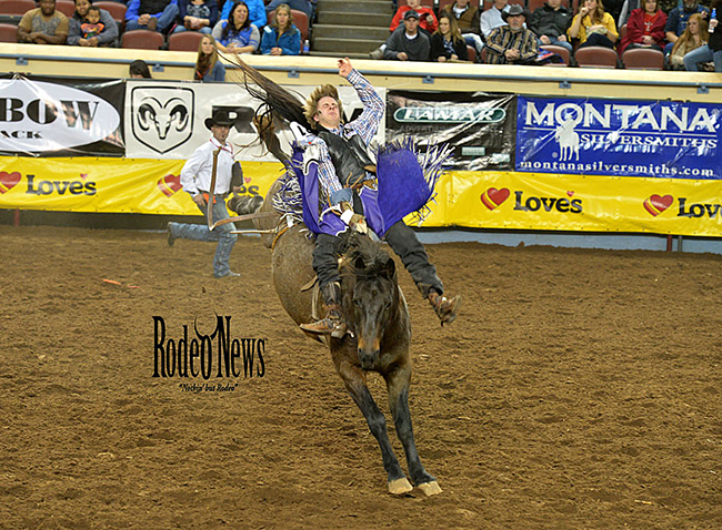 Spur Lacasse of Mirabel, Quebec, rides Hampton Rodeo's Black Water for 79.75 points to win the first round of IFR 45. (PHOTO BY LACEY STEVENS, RODEO NEWS)