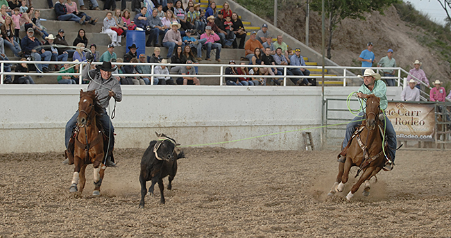 Colby Lovell, right, and Kory Koontz took the third-round lead at the Guymon Pioneer Days Rodeo with a 7.1-second run. They also lead the three-run aggregate. (ROBBY FREEMAN PHOTO)