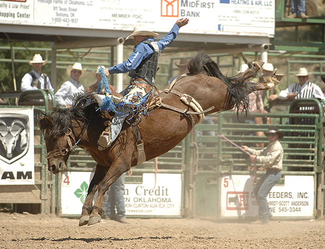 Taos Muncy rides Powder River Rodeo's Miss Chestnut for 88 points to take the lead at the Guymon Pioneer Days Rodeo. (ROBBY FREEMAN PHOTO)