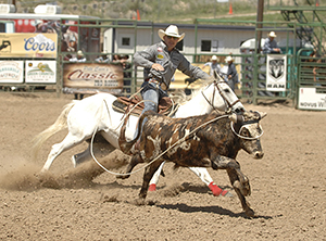 Tuf Cooper competes in steer roping on Saturday afternoon. He leads the five-round aggregate. (ROBBY FREEMAN PHOTO)