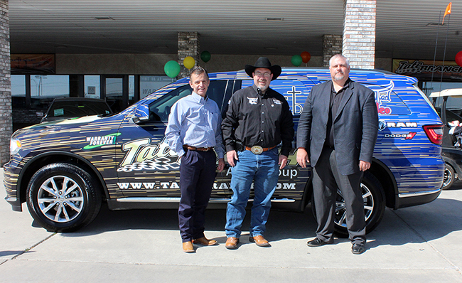 Tate Branch, Ted Harbin and Joby Houghtaling pose with Ted Harbin and his Rodeo Media Relations/TwisTed Rodeo Dodge Durango at the Hobbs, N.M., dealership. (LYNETTE HARBIN PHOTO)