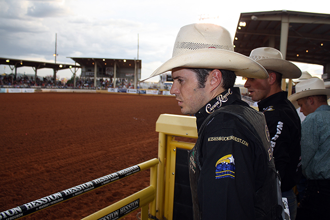 World champion bull rider Wesley Silcox watches the action as he prepares to ride at a recent Lea County Fair and Rodeo. Many of the top-named contestants find their way to Lovington, N.M., every August because of the top stock from Pete Carr Pro Rodeo.