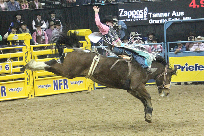 Tanner Aus rides J Bar J Rodeo's Hell On Hooves for 86.5 points on Monday night to finish second in the fifth round of the Wrangler National Finals Rodeo.