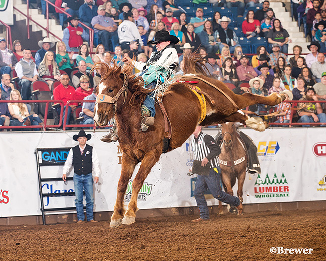 Tanner Aus rides J Bar J's Pass The Hat for 90 points to take the lead at the San Angelo Stock Show and Rodeo. It was the first time Aus has ridden for that score in his ProRodeo career. (PHOTO BY TODD BREWER)