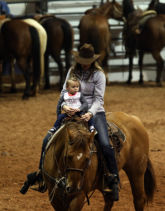 Rally Etbauer, the daughter of Trell and Kaylee Etbauer, rides in the arena with her aunt. (PHOTO BY STEPHANIE COOMBES)