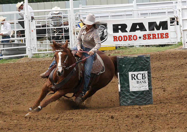 NFR qualifier Jean Winters of Texline, Texas, rounds the second barrel during a recent competition of the Will Rogers stampede. The 2016 edition of the award-winning rodeo will take place next week in Claremore, Okla.
