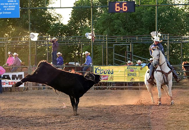 JoJo LeMond of Andrews, Texas, finishes off his team-roping run Friday with heeler Kory Koontz of Sudan, Texas. The tandem leads the third go-round, and LeMond put himself in position to earn this year's all-around title at the Guymon Pioneer Days Rodeo. (PHOTO BY JAMES PHIFER)