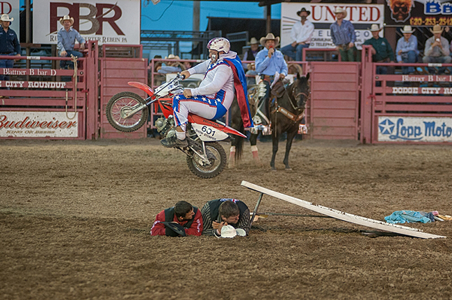 Four-time Clown of the Year Justin Rumford launches himself over a couple of willing participants during his act at a recent rodeo. Rumford will be featured at the Rooftop Rodeo, which begins in two weeks. (FRAN RUCHALSKI PHOTO)