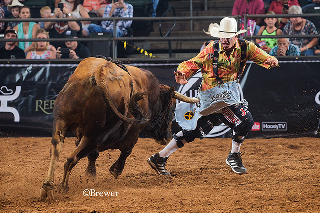Cody Webster matches moves with his fighting bull for 88.5 points to win the inaugural Bullfighters Only Cavender's Cup in Cedar Park, Texas. (TODD BREWER PHOTO)