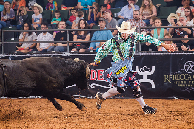 Dusty Tuckness battles a bull during a recent Bullfighters Only event in Cedar Park, Texas. Tuckness will be one of the bullfighters featured in Dodge City Roundup's A Whole Lotta Bull on Tuesday, Aug. 2. (TODD BREWER PHOTO)