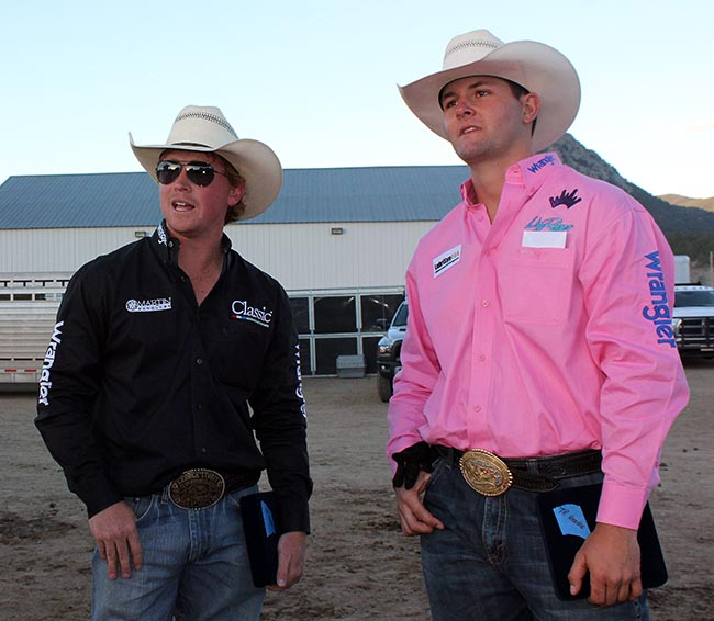 Team ropers Clint Summers, left, and Dustin Egusquiza look over the arena after winning the Rooftop Rodeo title Monday night. (LYNETTE HARBIN PHOTO)