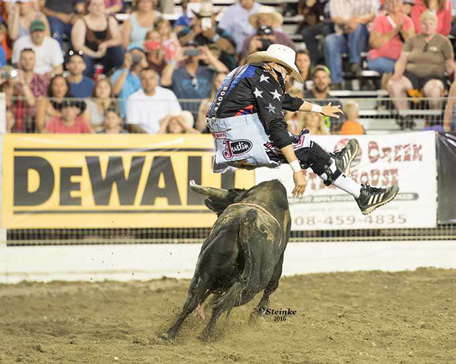 Cody Webster jumps his bull, Little Foot, during Tuesday's Bullfighters Only tour event in conjunction with the Caldwell Night Rodeo. Webster won the event with an 89.5-point fight. (KIRT STIENKE PHOTO)