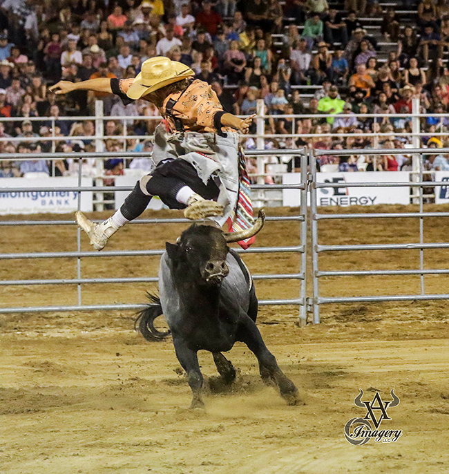 Beau Schueth jumps his bull, Hookin' A Ranch's Shed Hunter, to close out his fight Friday during the championship round of the Bullfighters Only event in Sikeston, Mo. (PHILLIP KITTS PHOTO)