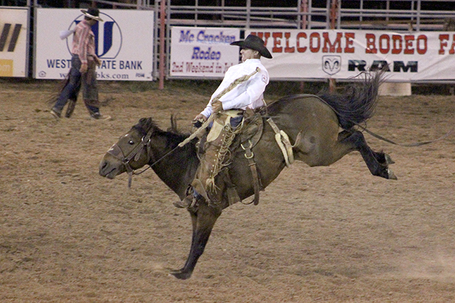Reid Green competes in ranch bronc riding during Friday's first go-round of the Kansas Professional Rodeo Association Finals. Green scored 74 points to win the opening round and move closer to the KPRA title.
