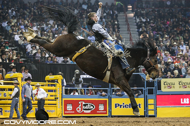 Orin Larsen rides Frontier Rodeo's Full Baggage for 87.5 points on Thursday night to win the eighth round at the Wrangler National Finals Rodeo. (COVY MOORE PHOTO)