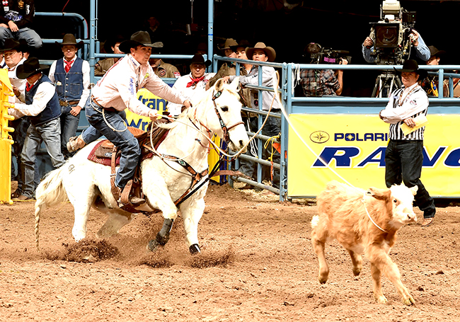 Ryan Jarrett ropes his calf in 7.4 seconds to finish in a tie for the ninth-round win Friday at the Wrangler National Finals Rodeo. (PRCA PHOTO BY GREG WESTFALL)