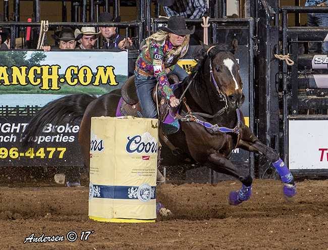 Amberleigh Moore riders her mare, Paige, to a 13.99-second run Sunday afternoon to take the second-round and average lead at the San Angelo Stock Show and Rodeo. (RIC ANDERSEN PHOTO)