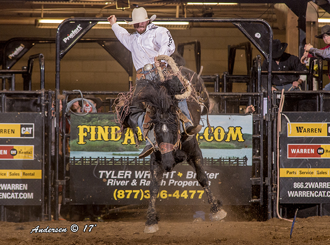 Cort Scheer C5 Rodeo's Classic Bear for 88 points to win the saddle bronc riding title Saturday at the San Angelo Cinch Chute Out. (RIC ANDERSEN PHOTO)