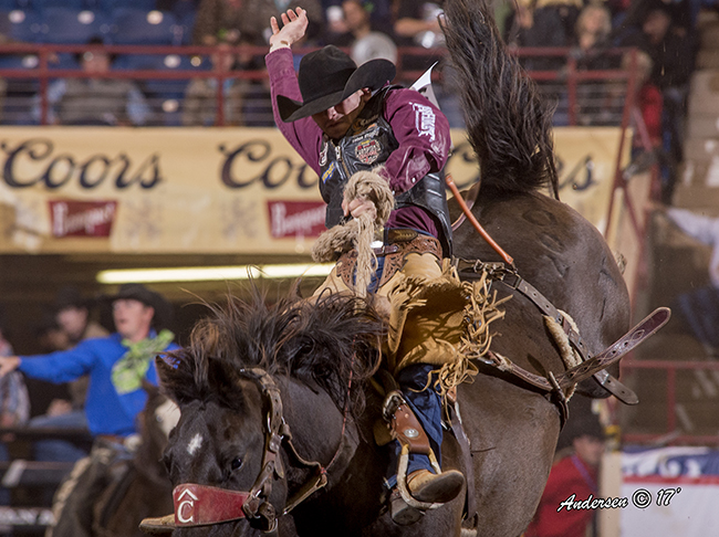 Joe Lufkin rides Pete Carr Pro Rodeo's Miss Congeniality for 83 points Wednesday night to take the saddle bronc riding lead at the San Angelo Stock Show and Rodeo. (RIC ANDERSEN PHOTO)