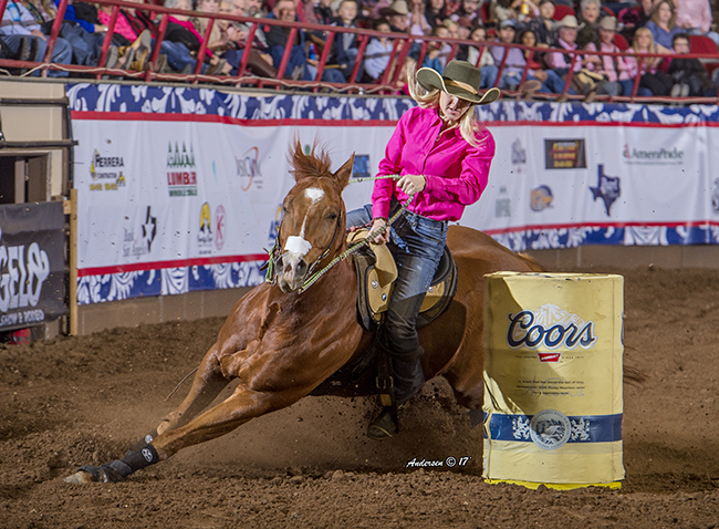 Tiany Schuster makes a turn during her 14.17-second run Thursday night at the San Angelo Stock Show and Rodeo. Schuster sits second in the average heading into Friday's championship round. (RIC ANDERSEN PHOTO)