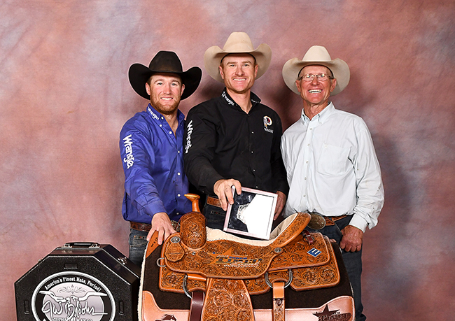 Jess Tierney, center, poses with his brother, Paul David, left, and his father, Paul. On Sunday, Jess became the third member of the family to win the CINCH Timed Event Championship. (JAMES PHIFER PHOTO)